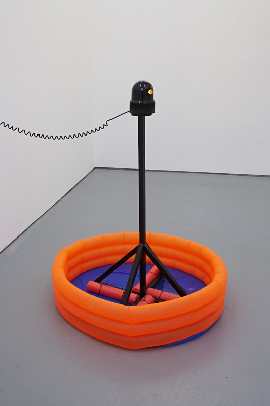 'I.P.C. 3/4' 2015, Wood, inflatable pool, foam rollers, rotating amber beacon with magnetic base 120 x Ø 90 cm
